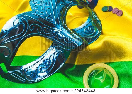 Carnival mask on brazilian flag background