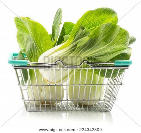 Fresh bok choy (Pak choi) in a shopping basket isolated on white background