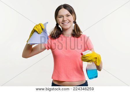 Cleaning day, spring cleaning. Girl teenager in protective gloves. White background