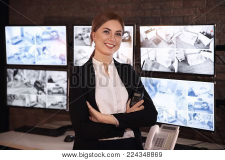Female security guard in surveillance room