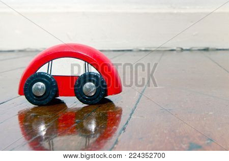 retro  red wooden car toy on a old wooden floor