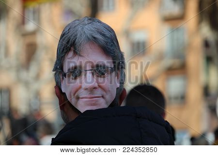 Barcelona, Spain - January 30, 2017: Concentration of people wearing a mask with the face of Carles Puigdemont on the day when it was supposed he was going to be voted president of Catalonia by Catalan parliament