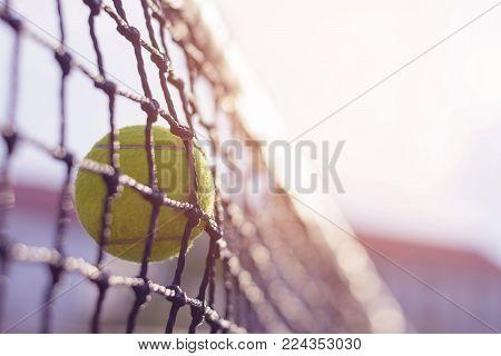 Close Up Tennis Ball Hitting To Net