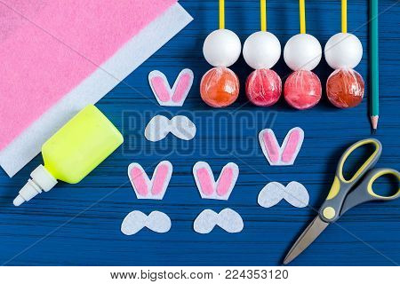 Making Easter bunny from lollipop. Sweet gift to children. Creative idea for children's party. DIY concept. Step by step photo instructions. Step 5. Glue pink details of ears