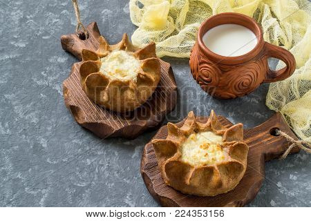 Traditional Karelian baking, rye pies wickets (kalitki) with cottage cheese. Diverse national cuisines of Russia. Ancient national food. Before eating wickets are wetted in hot milk