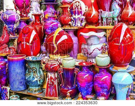 Chinese Red Multicolored Ceramic Pots Panjuan Flea Market  Beijing China. Panjuan Flea Curio market has many fakes, replicas and copies of older Chinese products, many ancient.