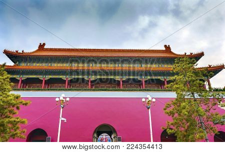 BEIJING, CHINA - NOVEMBER 13, 2017 Tiananmen Gate Rear Looking at Tiananmen Square Gugong Forbidden City Palace Wall Beijing China.  Chinese characters Say People of the World Emperor's Palace Built in the 1600s in the Ming Dynasty