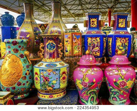 BEIJING, CHINA - NOVEMBER 13, 2017 Old Chinese Design Large Colrful Ceramic Vases Pots  Panjuan Flea Market  Beijing China. Panjuan Flea Curio market has many fakes, replicas and copies of older Chinese products, many