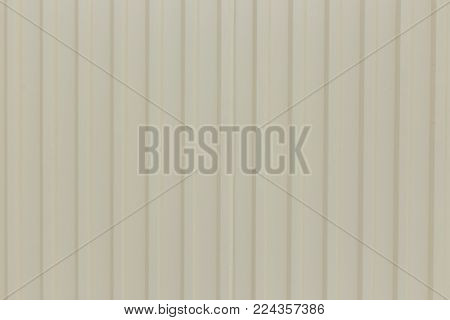 ilver-colored metal wall corrugated sheet metal background.