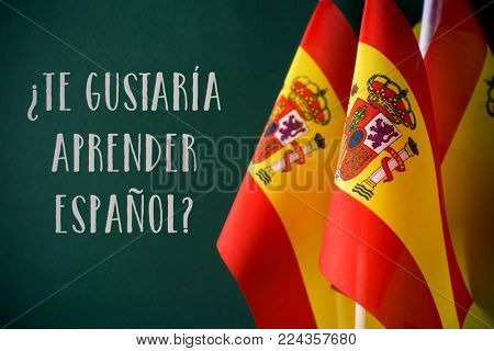 some flags of Spain and the question te gustaria aprender espanol?, do you want to speak Spanish? written in Spanish, against a dark green background