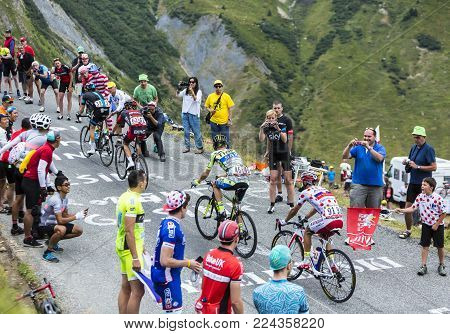Col du Glandon, France - July 24, 2015: A group of four cyclists ,climbing the road to Col du Glandon in Alps, during the stage 19 of Le Tour de France 2015.