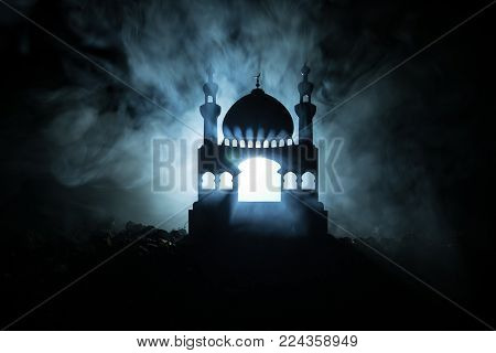 Silhouette Of Mosque Building On Toned Foggy Background. Ramadan Kareem Background. Mosque At Sunset