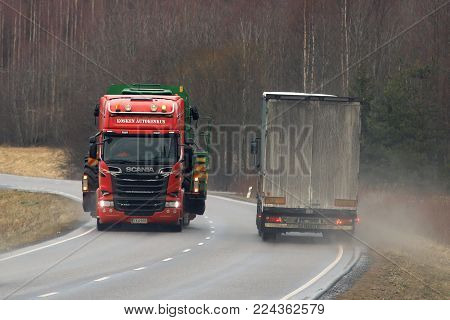 SALO, FINLAND - JANUARY 26, 2018: Semi truck gives way for a wide load transport on highway. The oversize transport was escorted by a pilot vehicle to warn traffic.