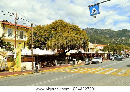 Ipsos, Corfu, Greece - September 29, 2017 : The main road going through Ipsos town past the beach