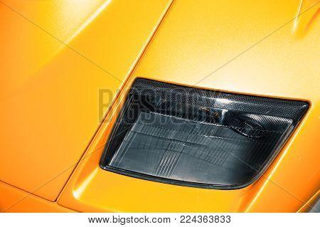 Headlight of luxury yellow roadster, Italian car design