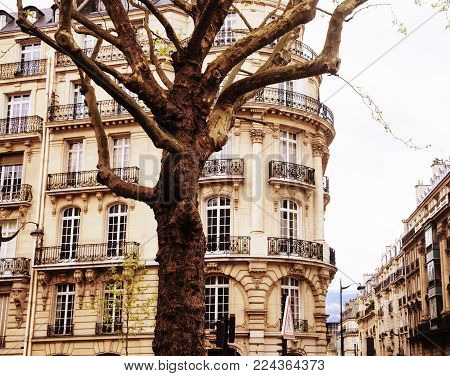 houses on french streets of Paris. citylife concept, black balcony lace close up