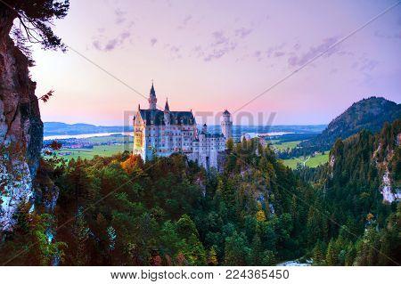 Neuschwanstein Castle In Bavaria, Germany At Sunset
