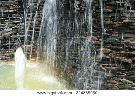 Detail Of A Decorative Cascade Waterfall In The Garden.