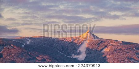 Morning sunrise at Jested Mountain and Jested Ski Resort. Winter time mood. Liberec, Czech Republic. Panoramic shot.
