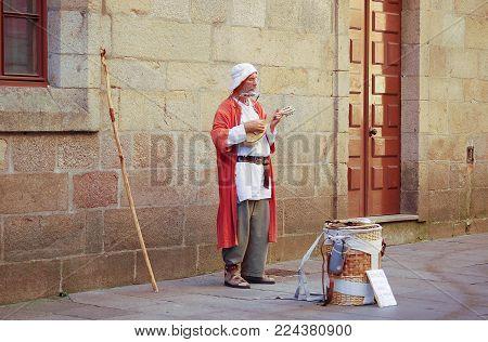 Busking pilgrim at the end of his Camino - Santiago de Compostela, Galicia, Spain, 8 October 2007