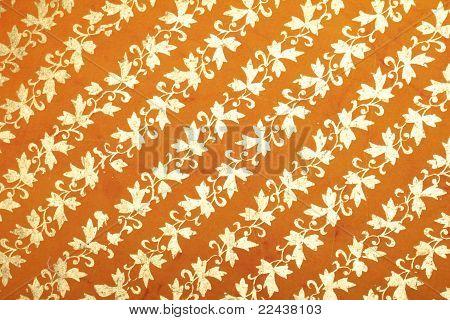 orange handmade art paper with floral pattern