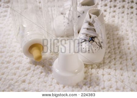 Baby Shoes And Bottle