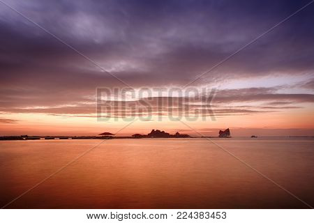 Sunset In The Tropical Sea Of Koh Loy Sriracha Coastal District Of Chonburi Province In Thailand,twi