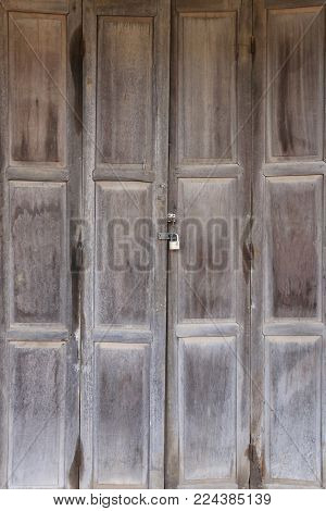 old wooden door that Locks closed for security in concept of presenting in your work.