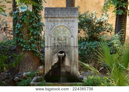 Old fountain in a park of Rhodes city, Greece