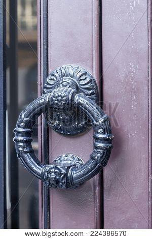 beautiful old iron door handle on wooden door