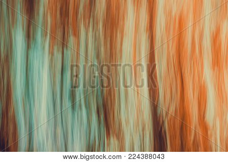 Abstract blurred landscape with movement effect.  Background with directional blur, motion effect and long exposure. Vertical lines and strips.