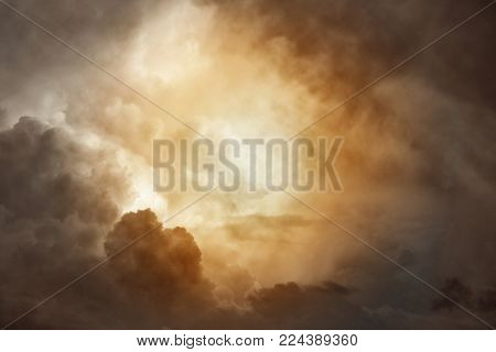 Sunlit clouds in heavenly sky