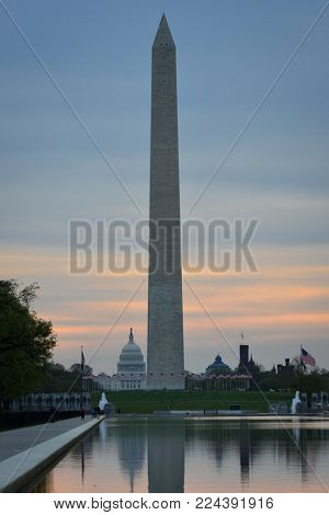 Washington DC, National Mall sunrise scene including World War II Memorial, the Monument and Capitol Building