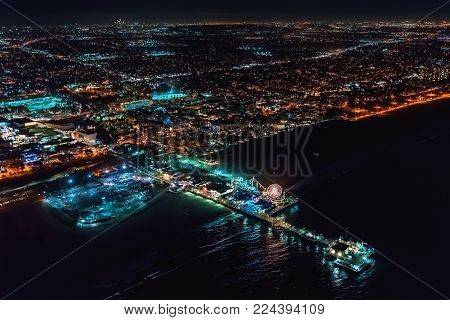 Aerial view of the Santa Monica shoreline, amusement park and pier at night