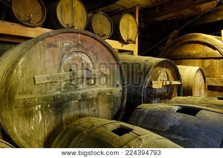 Old wine barrels in cellar close-up