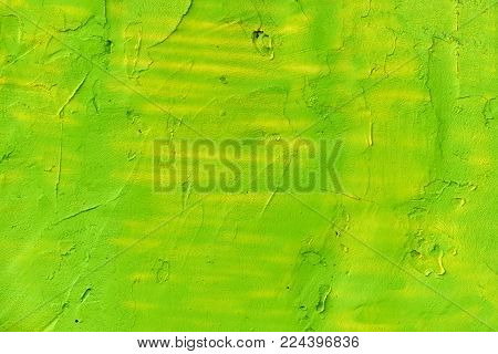 Modern abstract painted bright green street stone wall