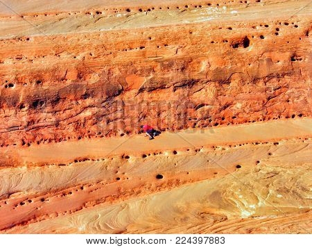 Late Afternoon Sunlight On Sandstone And Boy Climbing, Arches National Park, Utah By Delicate Arch,