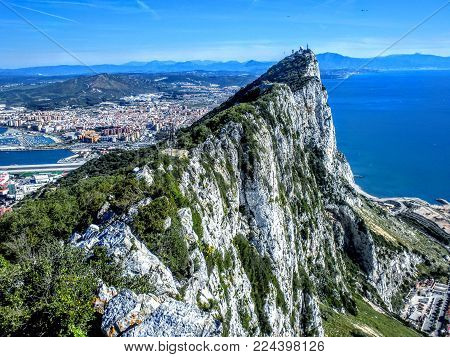 Aerial View Of Rock Of Gibraltar With City And Coastline In Background, Iberian Peninsula.