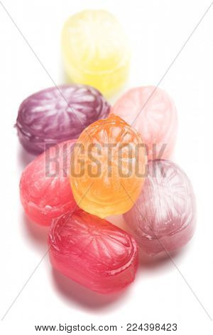 Hard candy sweets shot over white background
