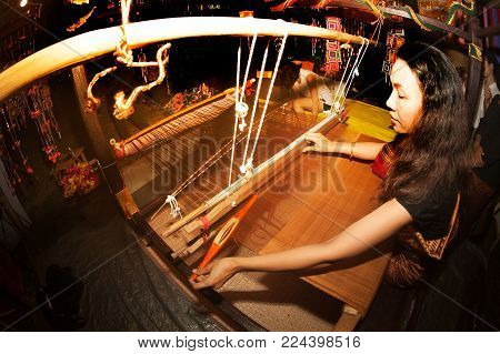 BANGKOK,THAILAND-JANUARY 27,2017 : Unidentified Female weavers are demonstrating how weaving on the job showing in Participants take part in the celebration of Thailand tourism festival, Lumpini park , Bangkok capital city,Thailand.