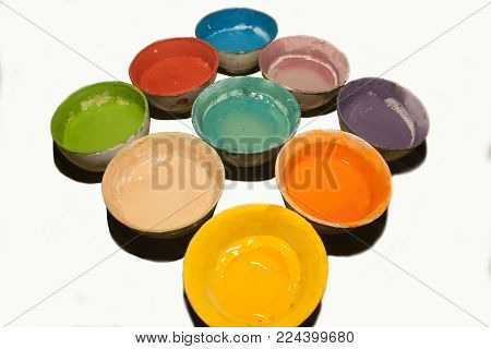Multicolored Plastic Cups With Paints On Bamboo Table Background, Art Tools For Artist Workplace On