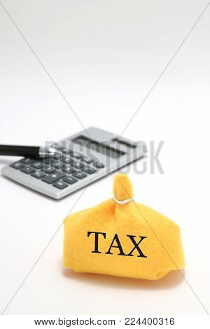 Money bag and caluculator on white background. Tax, save money and investment concept.
