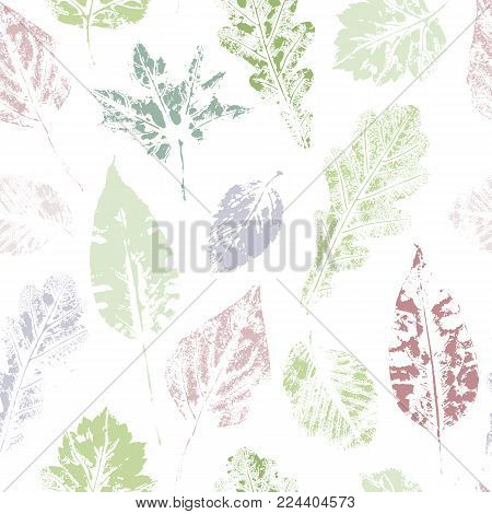 Colorful seamless pattern of spring leaves - maple, oak, birch and aspen, hand made ink print, stamp, vector illustration. Hand printed grunge style seamless pattern of spting, summer leaves