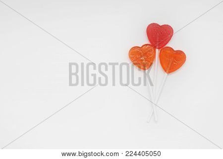Valentine's Day. Love and Sweet Love Concept. Three Candy Lolipop