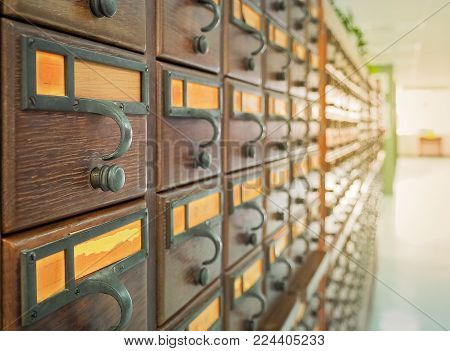 Vintage color image for wooden boxes with index cards in library, Selective focus and Close up image