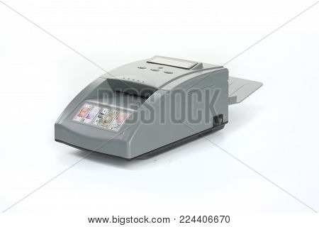 GOMEL, BELARUS - March 27, 2013: The device for authenticating the banknotes of the firm NTS Gomel on a white background