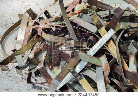 Remnant Of Iron, Leftover Of Iron Surplus On The Gray Concrete Floor Background.iron,aluminium,metal