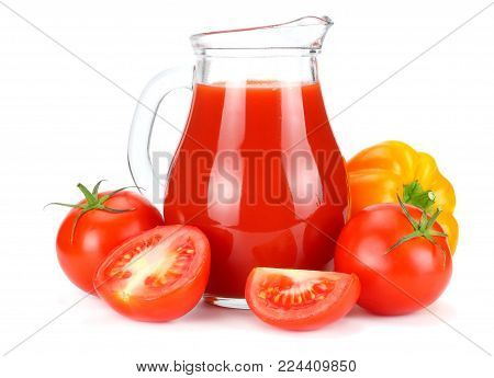 Tomato Juice In Glass Jug With Tomato, Garlic, Spices, And Basil Isolated On White Background