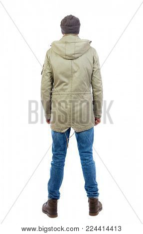 Back view of man in jeans. Standing young guy. Rear view people collection.  backside view of person.  Isolated over white background. A guy in a jacket and a hat is standing backside.