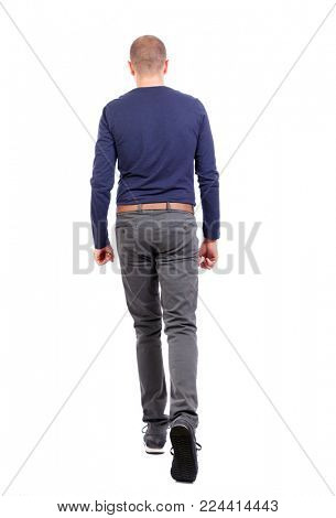 Back view of going  handsome man. walking young guy . Rear view people collection.  backside view of person.  Isolated over white background. a short-cut man in trousers goes forward.